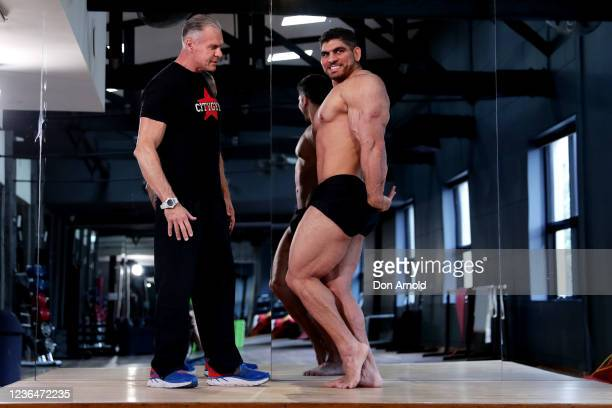 Chris Kavvalos practices posing manoeuvres under the watchful eye of PT Paul Haslam during a workout at City Gym on May 24, 2020 in Sydney,...