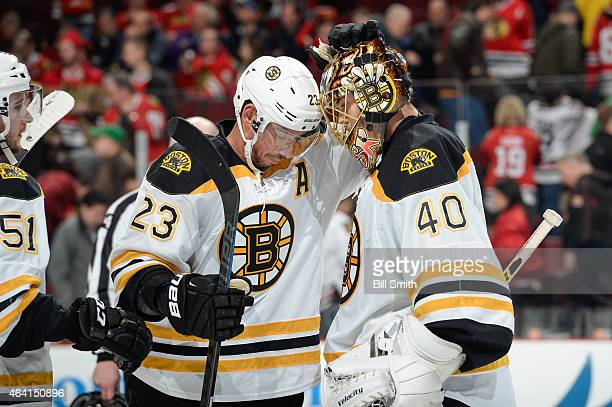 Chris Kelly and goalie Tuukka Rask of the Boston Bruins celebrate after defeating the Chicago Blackhawks 62 during the NHL game at the United Center...