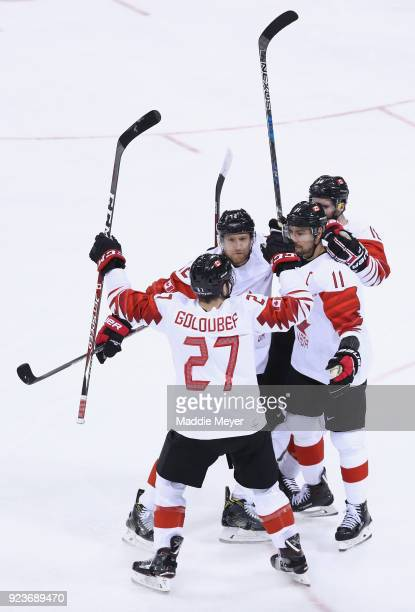Chris Kelly of Canada celebrates with teammates after scoring his team's second goal in the first period against Czech Republic during the Men's...