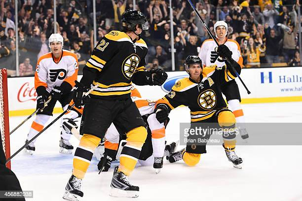 Chris Kelly of the Boston Bruins celebrates his goal for the lead against the Philadelphia Flyers during the season opener at the TD Garden on...
