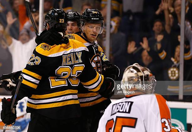 Chris Kelly of the Boston Bruins celebrates with Loui Eriksson and Carl Soderberg of the Boston Bruins in the third period after his gamewinning goal...