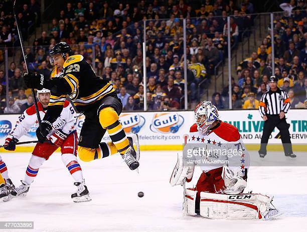 Chris Kelly of the Boston Bruins jumps in front of a loose puck in front of Braden Holtby of the Washington Capitals in the third period during the...