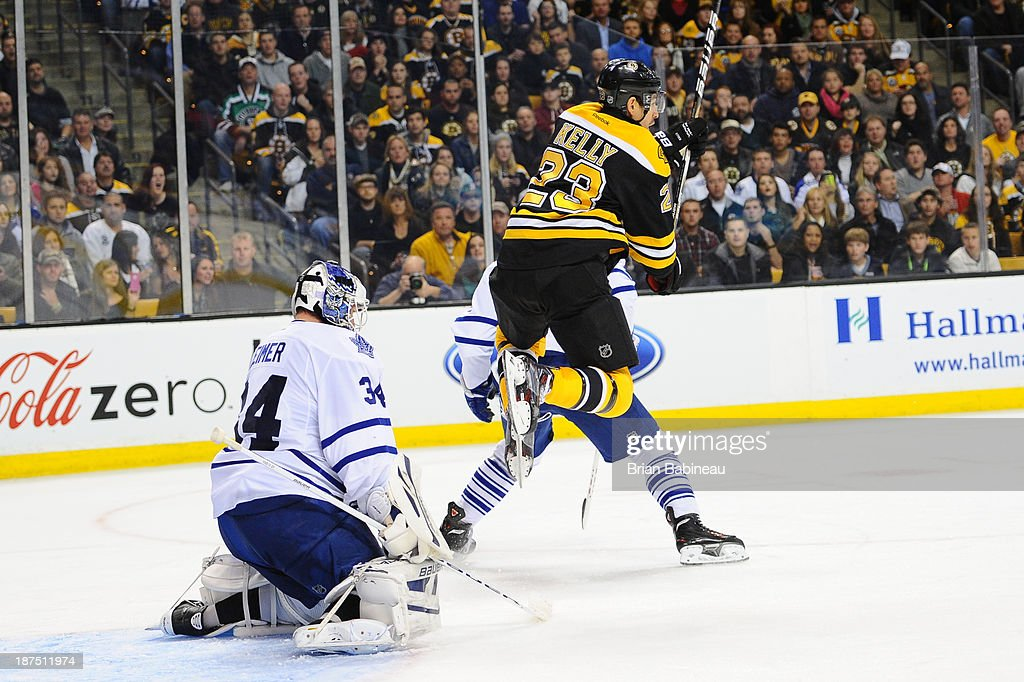 Chris Kelly #23 of the Boston Bruins jumps up during the play against James Reimer #34 of the Toronto Maple Leafs at the TD Garden on November 9, 2013 in Boston, Massachusetts.