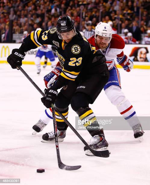 Chris Kelly of the Boston Bruins plays against the Montreal Canadiens during the game at TD Garden on March 24 2014 in Boston Massachusetts