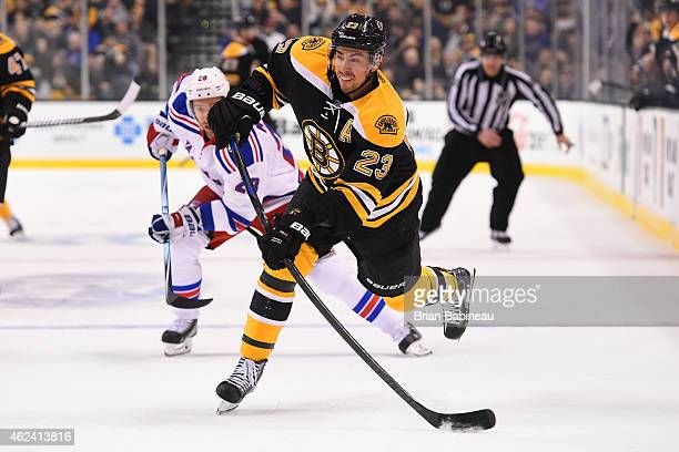 Chris Kelly of the Boston Bruins shoots the puck against the New York Rangers at the TD Garden on January 15 2015 in Boston Massachusetts