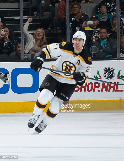 Chris Kelly of the Boston Bruins skates after the puck against the San Jose Sharks during an NHL game on December 4, 2014 at SAP Center in San Jose,...