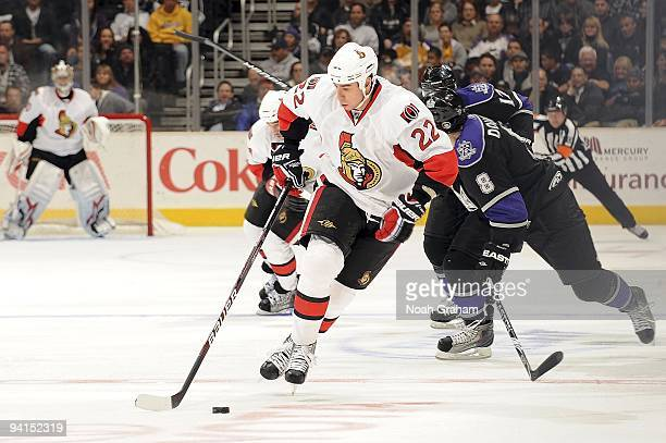 Chris Kelly of the Ottawa Senators drives the puck center ice against Drew Doughty of the Los Angeles Kings during the game on December 3, 2009 at...