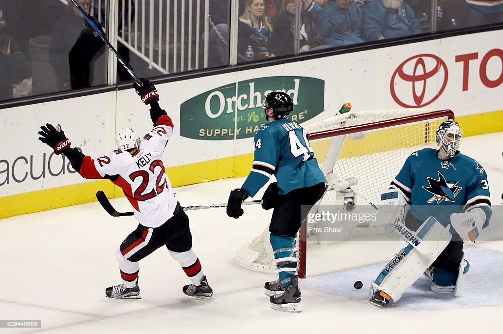 Chris Kelly #22 of the Ottawa Senators reacts after he scored on Marc-Edouard Vlasic #44 and Martin Jones #31 of the San Jose Sharks in the third period SAP Center on December 7, 2016 in San Jose, California.