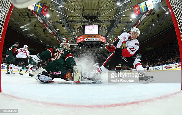 Chris Kelly of the Ottawa Senators scores a goal against Ari Ahonen of the Frolunda Indians at Scandinavium Arena on October 2 2008 in Gothenburg...