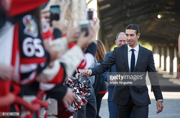 Chris Kelly of the Ottawa Senators walks the red carpet prior to the season opener against the Toronto Maple Leafs at Canadian Tire Centre on October...