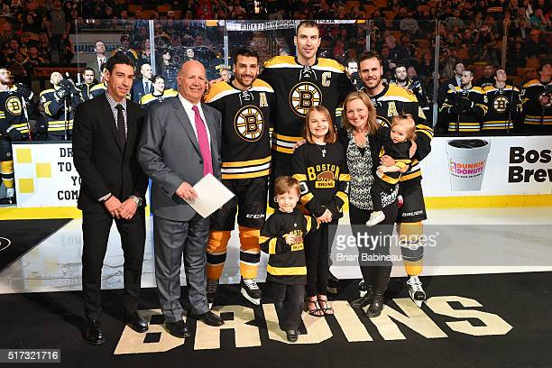 Chris Kelly Patrice Bergeron Zdeno Chara and David Krejci of the Boston Bruins present their head coach Claude Julien and his family with a trip to...