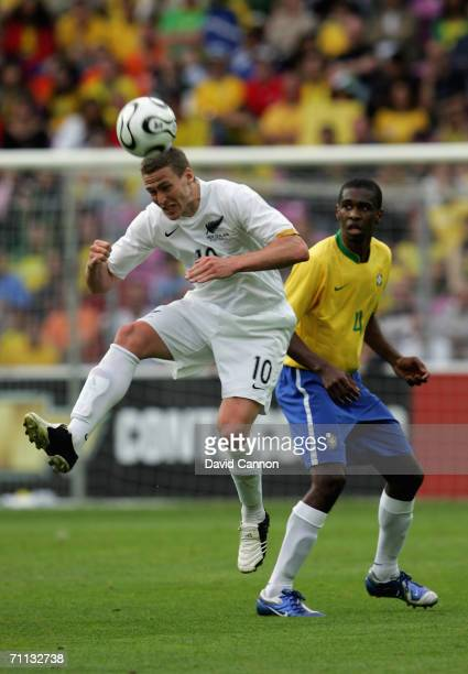 Chris Killen of New Zealand beats Juan of Brazil to the ball during the international friendly match between Brazil and New Zealand at the Stadium de...