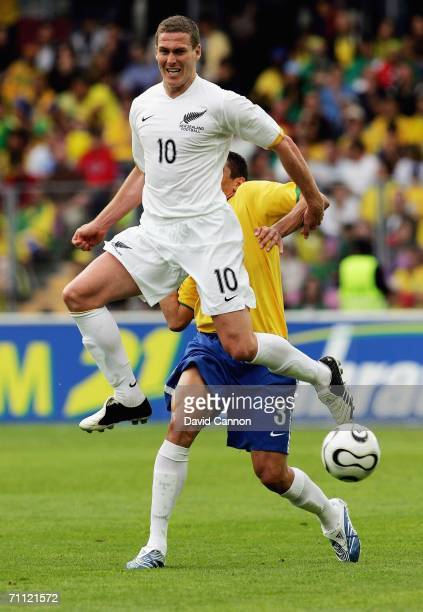 Chris Killen of New Zealand beats Lucio of Brazil to the ball during the international friendly match between Brazil and New Zealand at the Stadium...