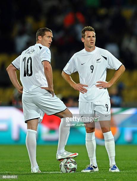 Chris Killen of New Zealand stands dejected flanked by his teammate Shane Smeltz after conceding a goal during the FIFA Confederations Cup match...