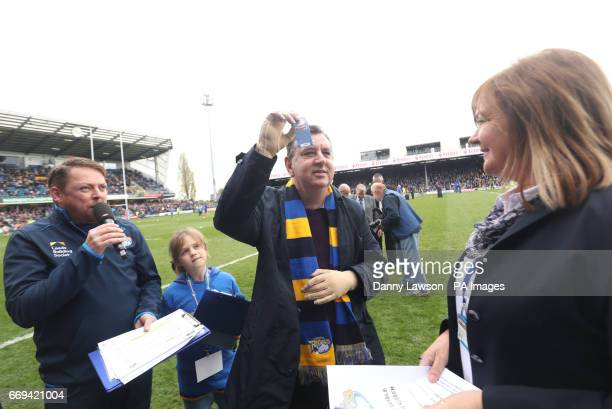 Chris King, the UK's first double hand transplant patient, holds up a Golden Gamble ticket after the Leeds Rhinos rugby league team ran onto the...