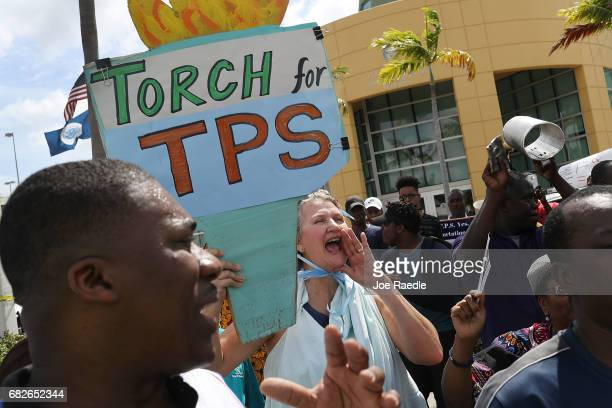 Chris Kirchner joins others as they protest the possibility that the Trump administration may overturn the Temporary Protected Status for Haitians in...