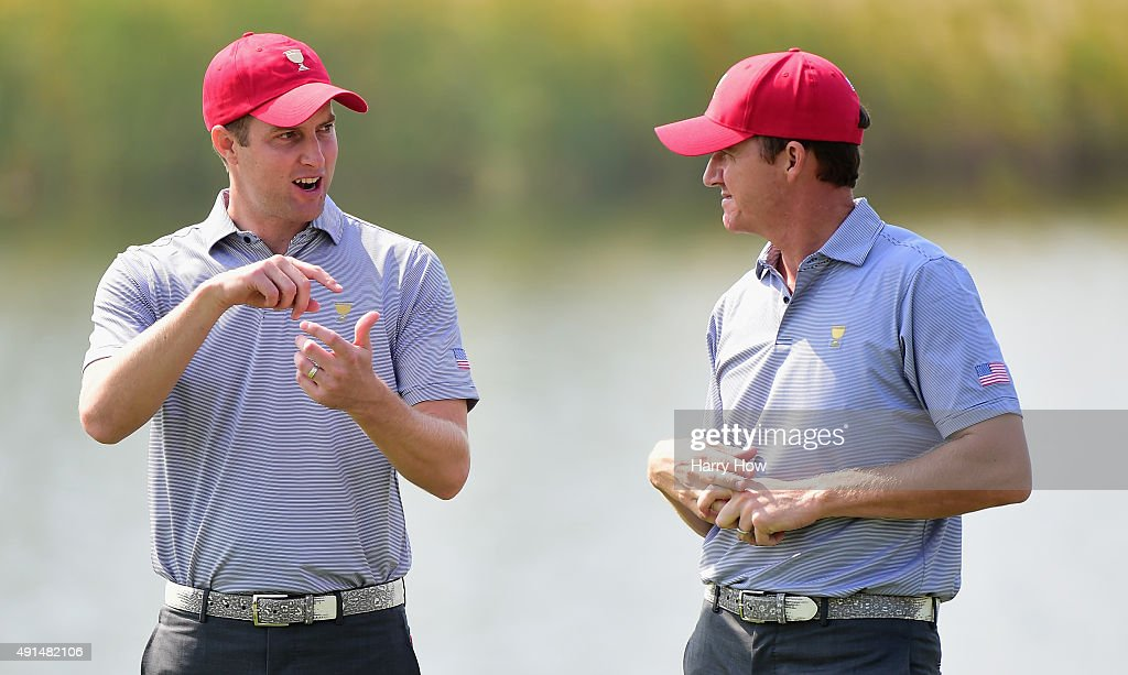 Chris Kirk and Jimmy Walker of the United States team talk on the fourth green prior to the start of The Presidents Cup at the Jack Nicklaus Golf Club on October 6, 2015 in Incheon City, South Korea.