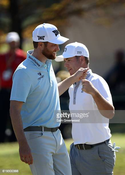 Chris Kirk and Luke List react on the fifth hole during the Final Round of the Sanderson Farms Championship at the Country Club of Jackson on October...