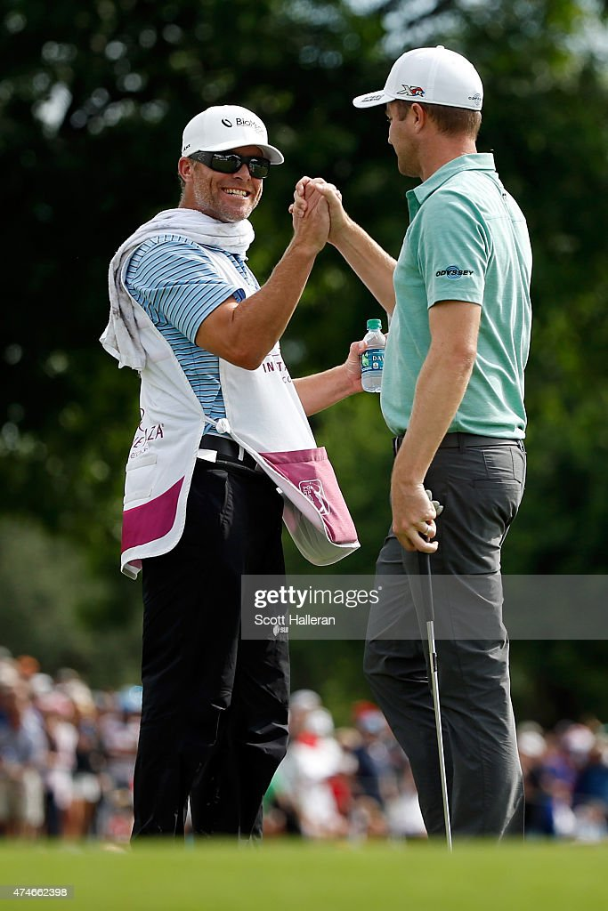 Chris Kirk celebrates with caddie G.W Cable on the 18th green during the final round of the Crowne Plaza Invitational at the Colonial Country Club on May 24, 2015 in Fort Worth, Texas.