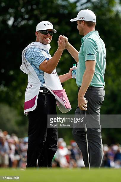 Chris Kirk celebrates with caddie GW Cable on the 18th green during the final round of the Crowne Plaza Invitational at the Colonial Country Club on...