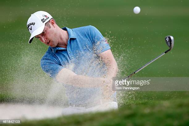 Chris Kirk hits out of a bunker on the 18th hole during the third round of the Sony Open in Hawaii at Waialae Country Club on January 11 2014 in...