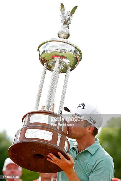 Chris Kirk kisses the Leonard trophy after winning during the final round of the Crowne Plaza Invitational at the Colonial Country Club on May 24...