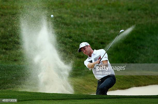 Chris Kirk of the United States hits his third shot from a bunker on the ninth hole during the first round of the 96th PGA Championship at Valhalla...