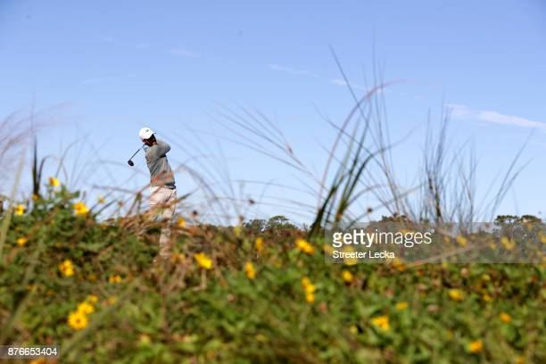 Chris Kirk of the United States plays his shot from the eighth tee during the final round of The RSM Classic at Sea Island Golf Club Seaside Course...