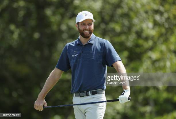 Chris Kirk of the United States reacts on the 17th tee during the first round of the Dell Technologies Championship at TPC Boston on August 31, 2018...