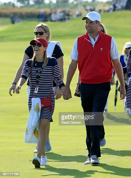 Chris Kirk of the United States team with his wife Thanee Kirk during the Thursday foursomes matches at The Presidents Cup at Jack Nicklaus Golf Club...