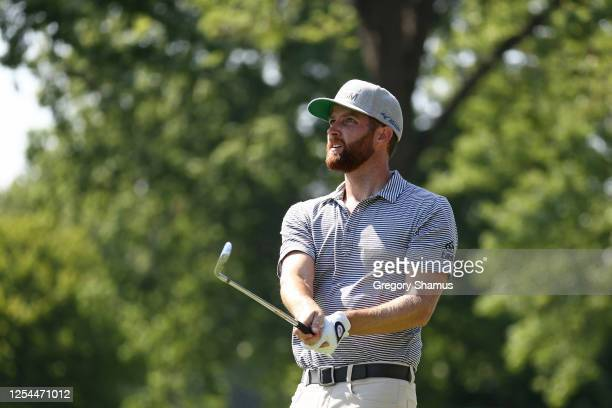 Chris Kirk of the United States watches his tee shot on the 15th hole during the final round of the Rocket Mortgage Classic on July 05 2020 at the...