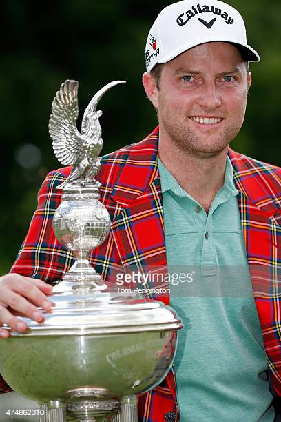 Chris Kirk poses with the Leonard trophy after winning during the final round of the Crowne Plaza Invitational at the Colonial Country Club on May 24...