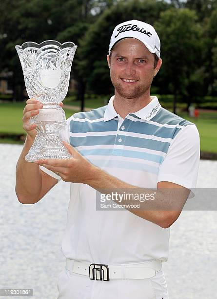 Chris Kirk poses with the trophy after winning the Viking Classic at Annandale Golf Club on July 17 2011 in Madison Mississippi