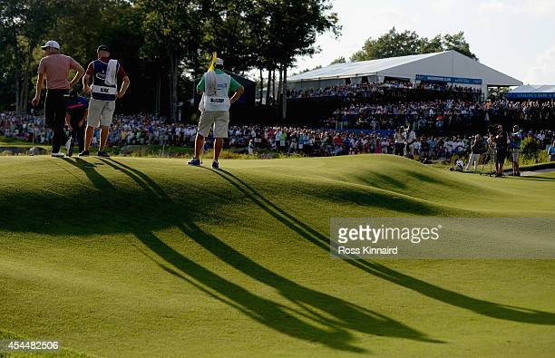 Chris Kirk waits to putt on the 18th hole during the final round of the Deutsche Bank Championship at the TPC Boston on September 1, 2014 in Norton,...