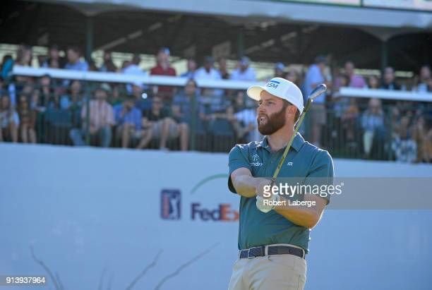 Chris Kirk watches his tee shot on the 16th hole during the third round of the Waste Management Phoenix Open at TPC Scottsdale on February 3 2018 in...