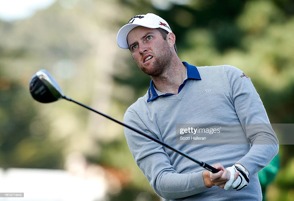 Chris Kirk watches his tee shot on the second hole during the final round of the AT&T Pebble Beach National Pro-Am at Pebble Beach Golf Links on February 10, 2013 in Pebble Beach, California.