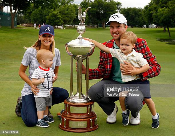 Chris Kirk with his wife Tahnee and his children Sawyer and Foster pose with the Leonard Trophy at the awards presentation at the Crowne Plaza...