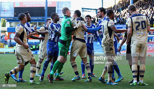 Chris Kirkland of Sheffield Wednesday breaks up a fight after Matt Smith of Leeds United challenge on Reda Johnson of Sheffield Wednesday during the...