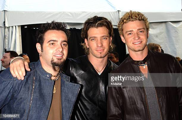 Chris Kirkpatrick JC Chasez and Justin Timberlake of 'N Sync arrive at the 29th Annual American Music Awards January 9 2002 at the Shrine Auditorium...