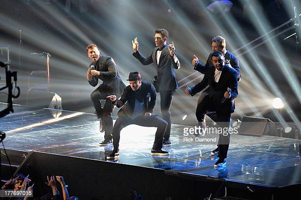 Chris Kirkpatrick Joey Fatone Justin Timberlake JC Chasez and Lance Bass of 'N Sync perform during the 2013 MTV Video Music Awards at the Barclays...