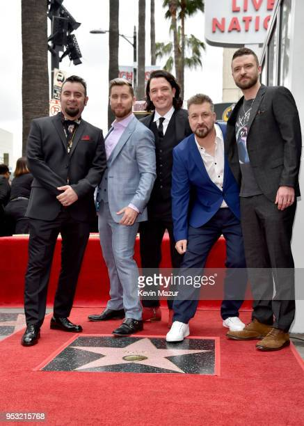 Chris Kirkpatrick Lance Bass JC Chasez Joey Fatone and Justin Timberlake of NSYNC are honored with a star on the Hollywood Walk of Fame on April 30...