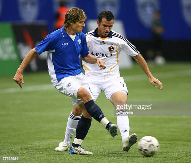 Chris Klein of the Los Angeles Galaxy and Peter Vagenas of the Vancouver Whitecaps battle for the ball during their exhibition soccer match against...
