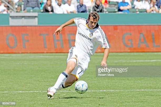 Chris Klein of the Los Angeles Galaxy attacks the defense of DC United during the MLS game at Home Depot Center on March 22 2009 in Carson California