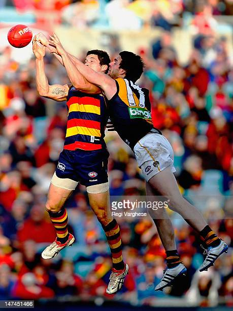 Chris Knights of Crows marks over Chris Newsman of Tigers during the round 14 AFL match between the Adelaide Crows and Richmond Tigers at AAMI...