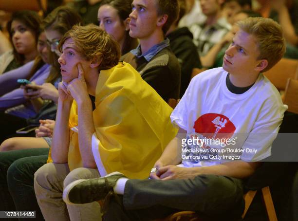 Chris Kohl left and Jacob Pauly watch the GOP presidential debate watch party in the Glen Miller Ballroom at CU David R Jennings staff photographer...