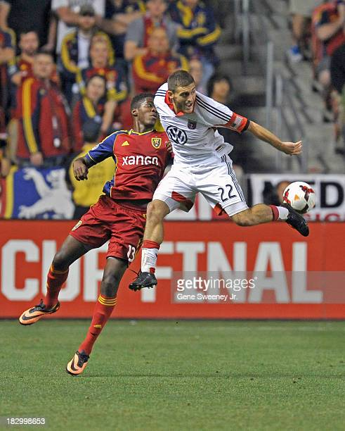 Chris Korb of DC United kicks the ball away from Olmes Garcia of Real Salt Lake during the 2013 US Open Cup Final at Rio Tinto Stadium October 1 2013...