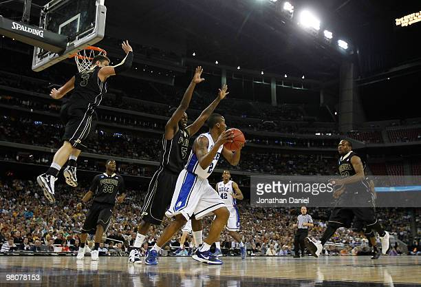 Chris Kramer Keaton Grant and Lewis Jackson of the Purdue Boilermakers defend against Nolan Smith of the Duke Blue Devils as he looks to pass during...