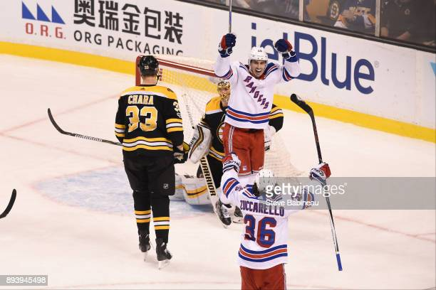 Chris Kreider and Mats Zuccarello of the New York Rangers celebrate an overtime goal to win the game against the Boston Bruins at the TD Garden on...
