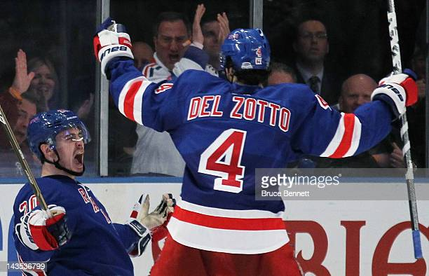 Chris Kreider celebrates his third period goal with teammate Michael Del Zotto of the New York Rangers in Game One of the Eastern Conference...