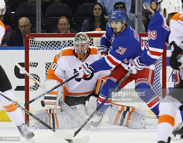 Chris Kreider of the New York Rangers attempts to deflect the puck past Michal Neuvirth of the Philadelphia Flyers during the first period at Madison...